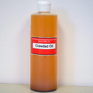 16oz bottle of orange colored Crawdad Oil.